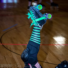Stretching (Vurnman) Tags: rollerderby derbygirls skaters norcal sacramento skate socks stripes quads leg