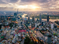 Aerial view of Ho Chi Minh City skyline and skyscrapers in center of heart business at Ho Chi Minh City downtown. Panorama of cityscape on Saigon river in Ho Chi Minh City at Vietnam at sunrise scene (MongkolChuewong) Tags: aerial aerialview architecture building business chi city cityscape condominium construction destination district drone dusk famous hall high ho hochiminh landmark landscape minh modern morning night office panorama panoramic port reflection river royalty saigon sky skydeck skyline skyscraper skyscrapers sunrise sunset tourism tower traffic travel urban vietnam vietnamese view water hochiminhcity hồchíminh vn