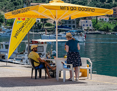 Yellow Boats (IanEdwards_uk) Tags: candid kefalonia greece greek yellow boats sail canopy chatting sitting chair vendor hire lets go boating