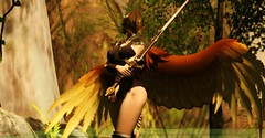 Ylva (Zumipop) Tags: secondlifephotography valkyrie wings sword helmet blondhair ponytail