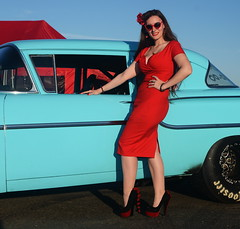 Holly_9229 (Fast an' Bulbous) Tags: classic american car vehicle chevy automobile girl woman hot sexy pinup model long brunette hair red wiggle dress high heels stockings nylons people outdoor sky santa pod