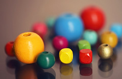 Assorted Colorful Beads (Through Serena's Lens) Tags: smileonsaturday multicolora stilllife macromondays multicolor macro assorted wood beads colorful bokeh dof canoneos6dmarkii 7dwf bright reflections