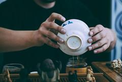 tea master at work (YellowTipTruck) Tags: teamasteratwork teaparty bunfight greentea tea crockery dishes teatable