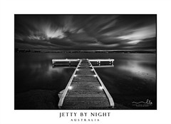 Timber jetty with moody skies at night (sugarbellaleah) Tags: jetty timber sky clouds moody stormy rain pier lights night evening blackandwhite longexposure nature lake lakemacquarie squidsinkjetty lakeside water reflection motion australia outdoors wooden planks