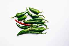 Top view of green and red chili peppers on white background (wuestenigel) Tags: spice heat color sweet line space chilli healthy hot plant food macro spicy seasoning pile peppers ripe isolated paprika white vegetable eating chili detail red pepperoni fresh chile indian green ingredient pepper jalapeno studio freshness object vitamin cayenne background culture organic