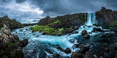 Oxararfoss, Thingvellir, Iceland (Tobias Schulte) Tags: waterfall wasserfall wasser water landscape landschaft black schwarz river fluss green grün grass gras rocks felsen stein stone cliff klippe bewegung movement panorama panoramic white weis clouds wolken cloudy bewölkt