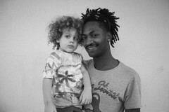 Carlitus e o puto fofo (RaquelMatos) Tags: blackandwhite bw ghetto kid child portrait man guy boy happy hapiness street urban life suburbs suburban faces face