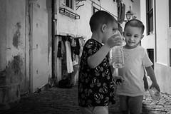 Twins (Peter Levi) Tags: bw blackandwhite blancoynegro blackwhitephotos lissabon lisboa lissbon boys children streetstyle streetphotography