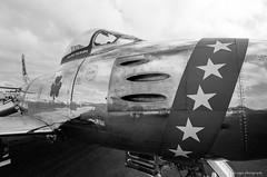 F-86 Sabre (dpsager) Tags: 2018 airventure bw dpsagerphotography eaa eaaoshkoshairshow eos1v f86 film kodak northamericanf86sabre oshkosh portra400bw sabrejet wisconsin aircraft airplane airshow osh18
