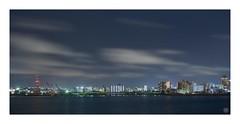 Night lights on Ocean (Hamilton Ross) Tags: ocean naha pacific water long exposure lights clouds motion night blur city cityscape