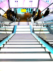 Ground Floor - Perfumery (Steve Taylor (Photography)) Tags: perfume bottle digitalart architecture stairs black blue pink white contrast yellow people lady woman uk gb england greatbritain unitedkingdom london lines airport heathrow terminal2 escalator