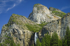 Yosemite's Cathedral (RobertCross1 (off and on)) Tags: a7rii alpha bridalveilfall ca california cathedralrocks e55210mmf4563oss emount ilce7rm2 mariposa sierranevada sierras sony valleyview yosemite yosemitenationalpark yosemitevalley bluesky cascade clouds forest fullframe granite landscape mirrorless mountains nature telephoto trees water waterfall