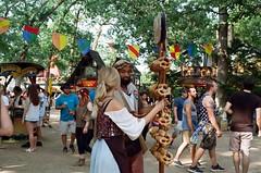 Preztels Anyone? (gjuarez49) Tags: renaissance fair lomography 100 minolta x700 film musket cosplay summer portait