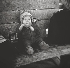 henryscapes, part three (manyfires) Tags: henry boy child baby son family love childhood portrait bw blackandwhite film analog peoplescape people holga plastic toycamera pnw pacificnorthwest bandon bench bundled