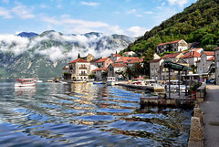Morning Clouds over Perast (Jocelyn777) Tags: water sea seascapes landscapes clouds mountains reflections waterreflections towns villages historictowns boats waves perast bayofkotor montenegro balkans travel