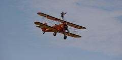 The Flying Circus Wingwalking Team, Shuttleworth Collection Family Air Show, Bedfordshire (IFM Photographic) Tags: img4005a breitlingstearman breitling stearman theflyingcircuswingwalker wingwalker wingwalking nikita aerosuperbatics canon 600d sigma70200mmf28exdgoshsm sigma70200mm sigma 70200mm f28 ex dg os hsm apo tele converter 2x af teleconverter oldwarden bedfordshire beds shuttleworthcollection shuttleworthhouse familyairshow airshow aircraft aeroplane plane airplane boeing