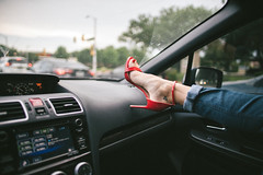they say it's dangerous to rest your feet on the dash. (michael spear hawkins) Tags: 24mm lenstagger ankle anklestrap canonfd24mmf14 dash dashboard driving f14 feet foot girl highheeled highheels jeans kelly leg redlight samedelman sandal subaru toes traffic wrx