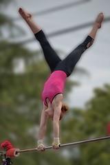 It's A High Bar (Scott 97006) Tags: girl parade performance highbar apparatus strength coordination form