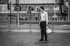 Business As Usual (Leanne Boulton (Away)) Tags: urban street candid portrait streetphotography candidstreetphotography candidportrait streetlife man male work working business businessman skater skate skateboard wheels rolling transport lunchtime lunch break district sign juxtaposition face expression posture post pole tone texture detail depthoffield bokeh naturallight outdoor light shade city scene human life living humanity society culture people lifestyle board canon canon5dmkiii 70mm ef2470mmf28liiusm black white blackwhite bw mono blackandwhite monochrome glasgow scotland uk