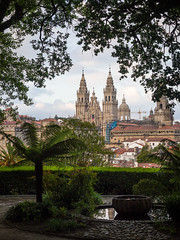 Catedral de Santiago (Adrián Nieto Rodríguez) Tags: tourism building exterior pond townscape famous place old town tree steeple promenade fountain reflection santiago compostela de cathedral arc trees frame fern galicia spain travel emblematic historic catedral light shadow alameda water