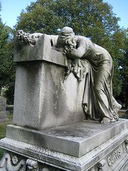 Mourner Statue Holding Flowers Grave Memorial 0982 (Brechtbug) Tags: mourner statue sculpture grave memorial tomb profile graveyard marble cemeteries nyc monument cemetery woodlawn horn tombstone crypt standing holding hands bronx new york city photographed 2007