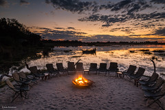 Safari tales by the fireplace (He Ro.) Tags: 2018 botswana kanana sunset afterglow atmospheric fireplace reflections sky colours clouds safari africa afrika botsuana southernafrica wilderness nature outdoor landscape waterscape lagoon okavangodelta xudumriver