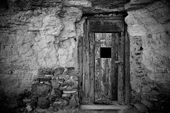 The red door (Marc Briggs) Tags: dsc8703cw deathvalley deathvalleynationalpark monochrome blackandwhite door doorway shoshone dublingulch