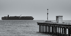 Crossing Paths (James C. Photography) Tags: felix stowe pier boat container ship black white cargo dull hazy huge