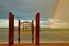 End of the rainbow (Geoff Henson) Tags: rainbow sea ocean water sky pier ruin posts pillars beach clouds longexposure rain wet