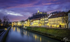 Ljubljana (Themightyoak) Tags: ljubljana slovenia city town river water glow reflections sky dusk blue hour sunset travelphotography travel photographer lights architecture castle hill night banks grass purple pink canon old oldcity historic history medieval