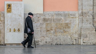 Old man going to the church