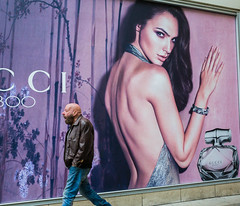 Manchester 079 (Peter.Bartlett) Tags: ricohgr postergirl people city urbanarte colour lunaphoto man urban candid uk poster wall walking unitedkingdom sign peterbartlett streetphotography facade manchester england gb