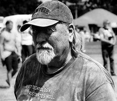 When Technology Frustrates You. (Neil. Moralee) Tags: neilmoralee steamrally2018neilmoralee man face portrait hat beard black white bw bandw blackandwhite mono old mature elderly technology frustration frustrate frustrating sunny outdoor people neil moralee olympus omd em5 staem rally norton ftzwarren candid