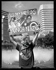 Punch Nazis Sign 1808xx (jimhairphoto) Tags: street protest demonstration streetlife streetstories théâtrederue portland oregon america pdx portlandnw remainsoftheday naturalworld 4x5project crown graphic camera mfg1963 4x5 ilford hp5 film blackandwhite blancetnoir schwarzweiss blancoynegro blancinegre siyahrebeyaz jimhairphoto
