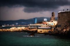 Lumière sur la porte d'orient (vedebe) Tags: couleurs ville city port rue street urbain urban mer mediterranée bateaux monument tour lumière orage nuages marseille architecture