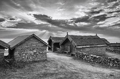 Fishing village (gnarlydog) Tags: rural blackandwhite monochrome bw village house stonehouse traditional oldschool dramatic sky clouds sweden