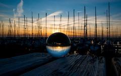 Sunset thru the glass ball (tomaszbaranowski007) Tags: light nature boat sun holland lelystad haven sunset