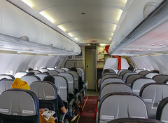 Interior of a Vietjet Air airplane (phuong.sg@gmail.com) Tags: air aircraft airline airplane airport aisle arrival board business cabin chair class commercial corridor destination economy flight fly holiday indoor inside interior jet journey low luggage man passenger people plane public row seat seating service sit stewardess tourism tourist transport transportation travel trip vacation voyage