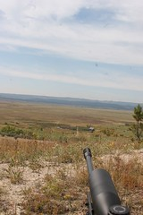 This rifle muzzle (338 Lapua )Savage Model 10 is pointed out over a section of county road, high line wires, a ranch house, and cattle pens. (huntingmark) Tags: guntest gun rimfire optics testing shooting field range warmup target longrange 308win wildcat hunter expert scope sniper itacha nightforce 65creedmoor creedmoor ruger chassis rifle hunting 300win blackout hornady