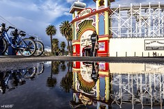 Luna Park (red stilletto) Tags: stkilda stkildamelbourne stkildabeach lunapark lunaparkstkilda themepark amusementpark winter rain puddle reflection reflections palmtrees famousflickrfive