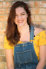 Kahlan (Szemak Photography) Tags: happy smiling print flowers croptop yellow overalls young jeans wall brickwall brick beautiful nature summer light redhead portaiture nikon bokeh woman girl outside outdoors portrait black lace laughing