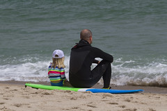 A Moment (brucetopher) Tags: surfer vacation holiday beach sea ocean surf wave waves surfing zen observing readingthewater watching watch wetsuit dad father daughter sand surfboard coast coastal seacoast green blue breakers break lineup shorebreak