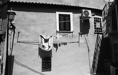 Ordine di grandezza (michele.palombi) Tags: crotone calabria italy panni bucato film 35mm ilford panf50 ombre città vecchia absoluteblackandwhite