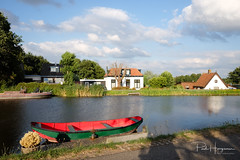 Red boat @ Kromme Mijdrecht (PaulHoo) Tags: fujifilm x70 2018 summer boat kromme mijdrecht red architecture house river water reflection