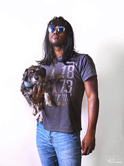 For the hell of it. (Philip Bonneau) Tags: man dog wiredhaireddachshund dachshund wig glasses portrait africanamerican blackman humor