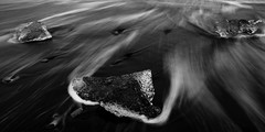 Diamonds in the Sand (Trevan Hiersche) Tags: iceland north nordic cold winter ice sand blacksand beach diamond jökulsárlón travel water ocean waves longexposure explore friends scandinavia