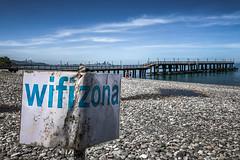 Wifizona (Melissa Maples) Tags: batumi batum ბათუმი adjara აჭარა georgia gürcistan sakartvelo საქართველო asia 土耳其 apple iphone iphonex cameraphone spring მწვანეკეპი mtsvanecape blacksea sea water beach blue pier skyline wifizona text sign