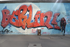 Berlin Wall (amy.hostetter) Tags: east side gallery german germany berlin wall color art graffiti person girl stand red blue