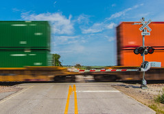Racing over the Crossing (Troy A. Snead) Tags: slowshutterspeed intermodals intermodaltrains containers motionblur carrollia uptranscon upboonesubdivision
