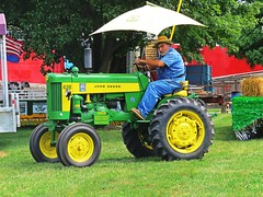 IMG_7625 (kennethkonica) Tags: indianastatefair people animals faces indiana indianapolis indy canonpowershot canon usa midwest america hoosier magicmoment persons color animalplanet animal summer fun fairground fair johndeere tractor umbrella